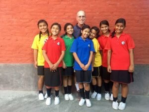 Founders Desk Bruce Keenan with Nepal Children