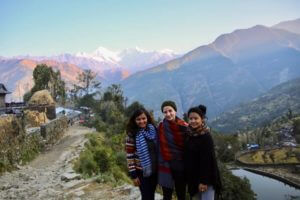 HCC Nepal Mumaya in Front of mountains with Friends